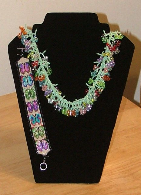 this is a picture of a order from a friend, she want my coral necklace but wanted butterflies on the ends instead and a peyote style butterfly bracelet. So her was my designs and she loved them.