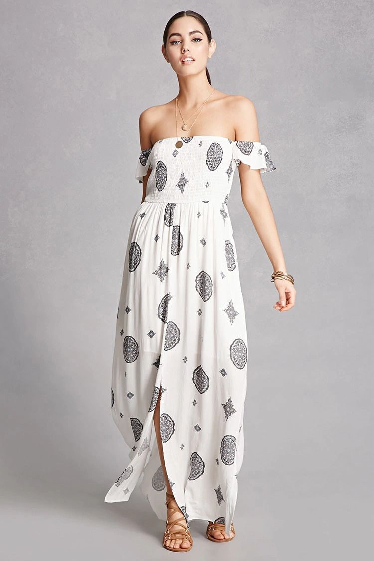 05f9a0af0a3 A woven maxi dress by Blush Noir™ featuring an allover geo print