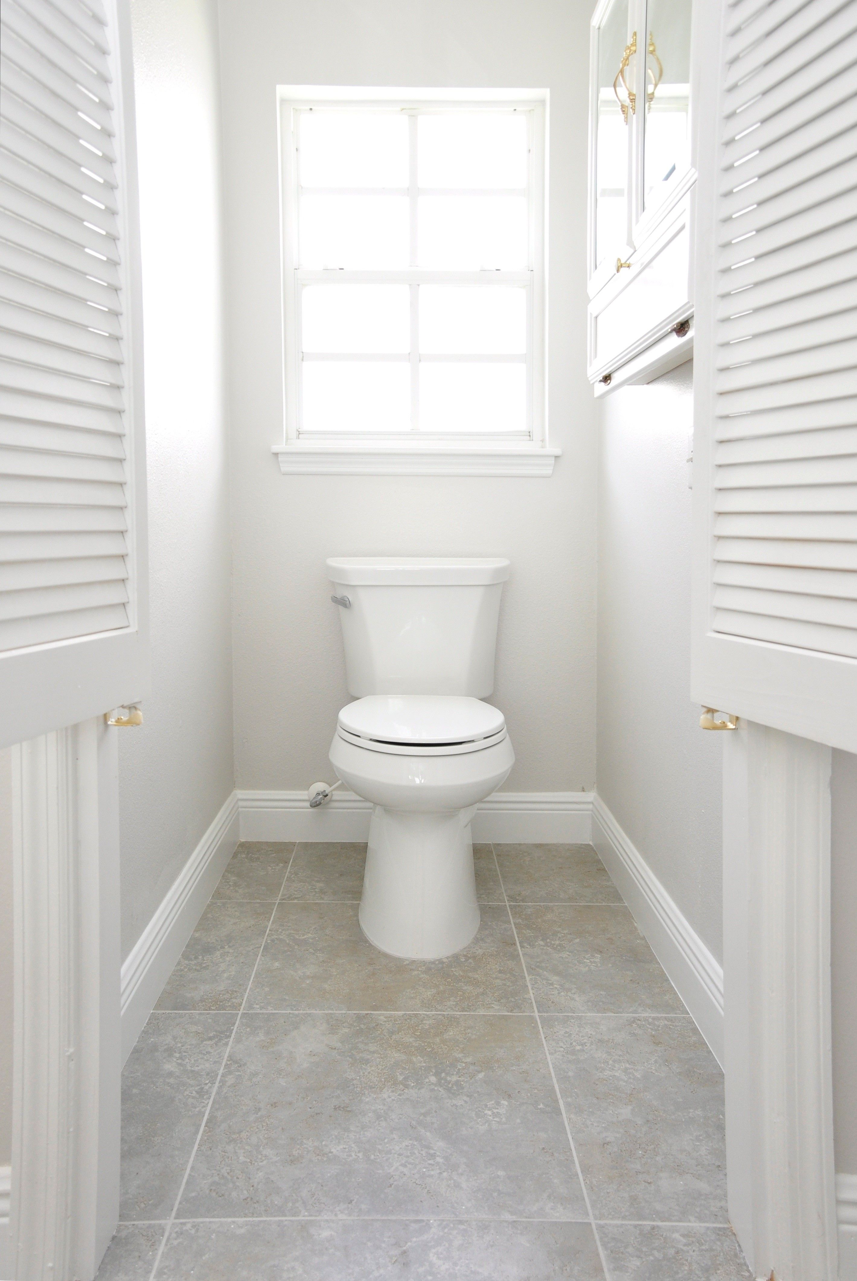 White Neutral Toilet Bathroom With Window Medicine Cabinet And