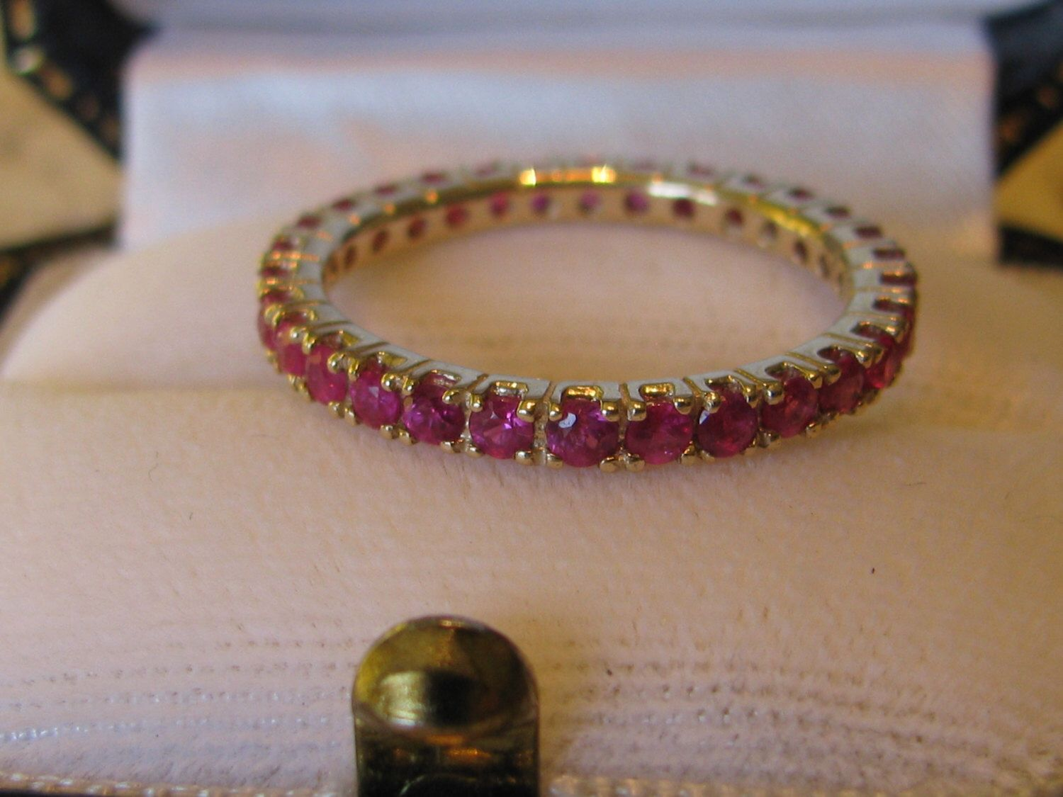 Natural Ruby Eternity Band Ring 1.00 Full Carat in Yellow Gold Size 7 by RozieTreasures on Etsy https://www.etsy.com/listing/463233505/natural-ruby-eternity-band-ring-100-full