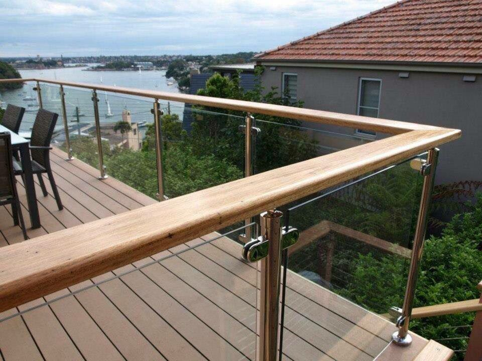 Glass balustrade with timber top rail glass balustrade for Exterior timber decking