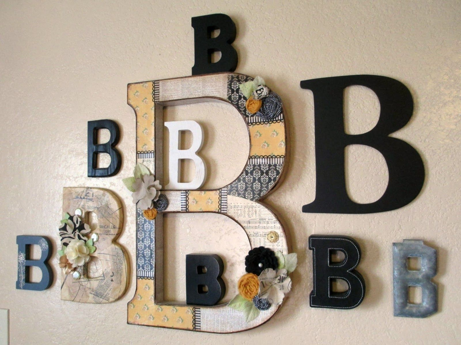 Monogram Wall. I like the big letter in the center, surrounded by smaller  letters