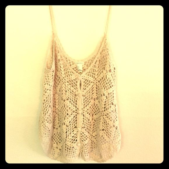 Crocheted 70's style boho tank top Crocheted 70's style cream tank top by Forever 21. Size small but with fairly long straps. Super cute boho vibe. Forever 21 Tops Tank Tops