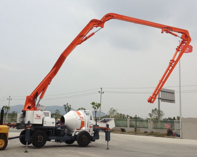 Mixing And Pumping Are Completed By One Operator Boom Movements Are Controlled By Radio Remote Controller Cement Truck Concrete Mixers Caterpillar Equipment