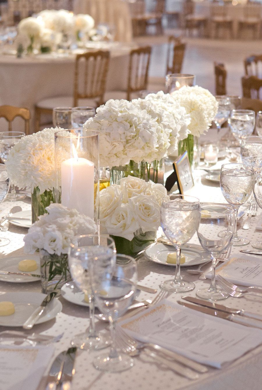 all white. candles, flowers, table, plates Hydrangea