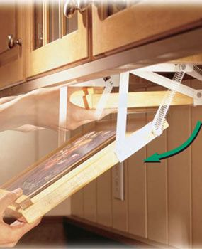 Swing-down cookbook rack?! Using this for the tablet. Sa-weet!