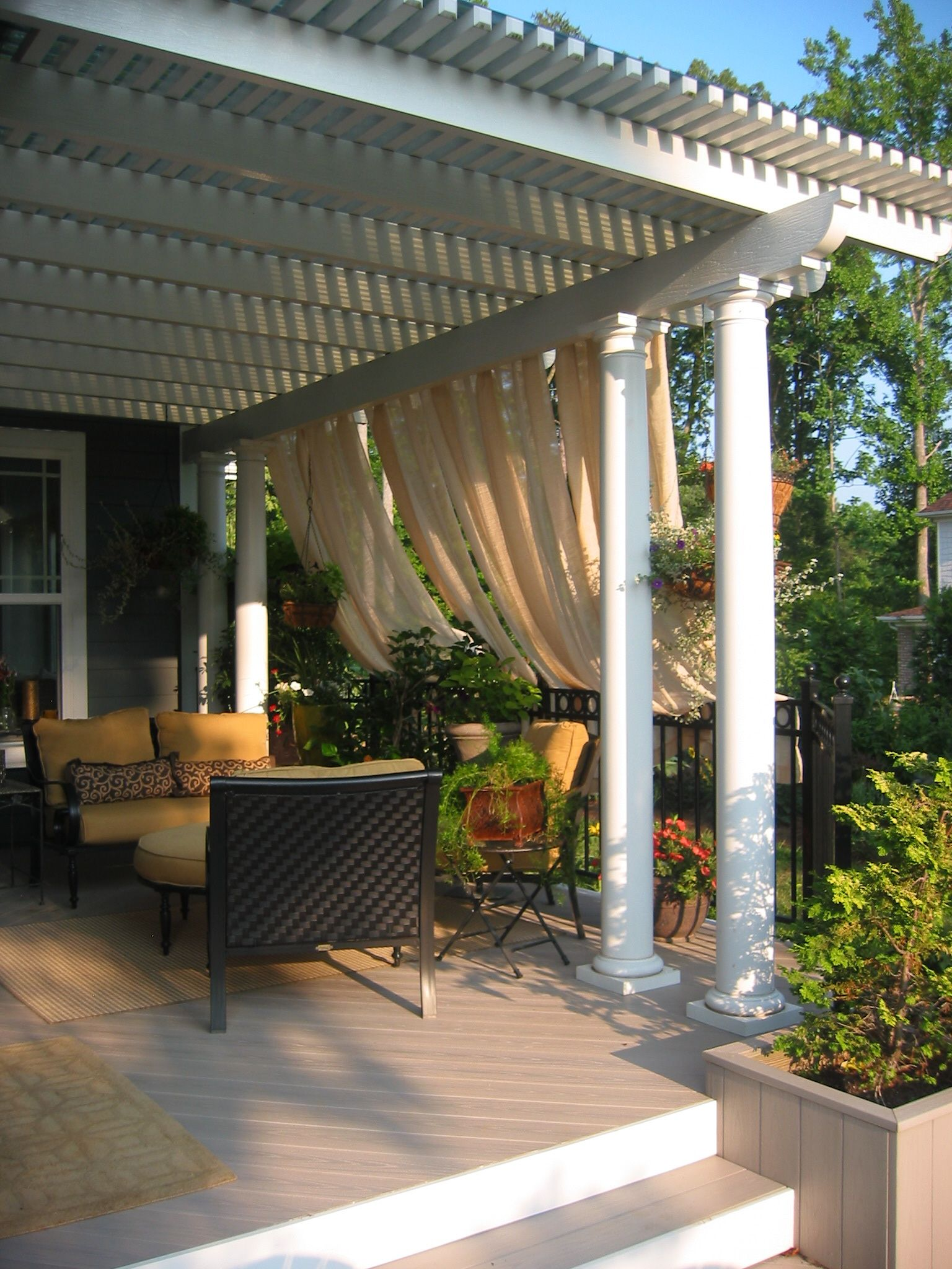 Pergola with polycarbonate roof and curtains creates an intimate outdoor space archadeck - Pergola with roof ...