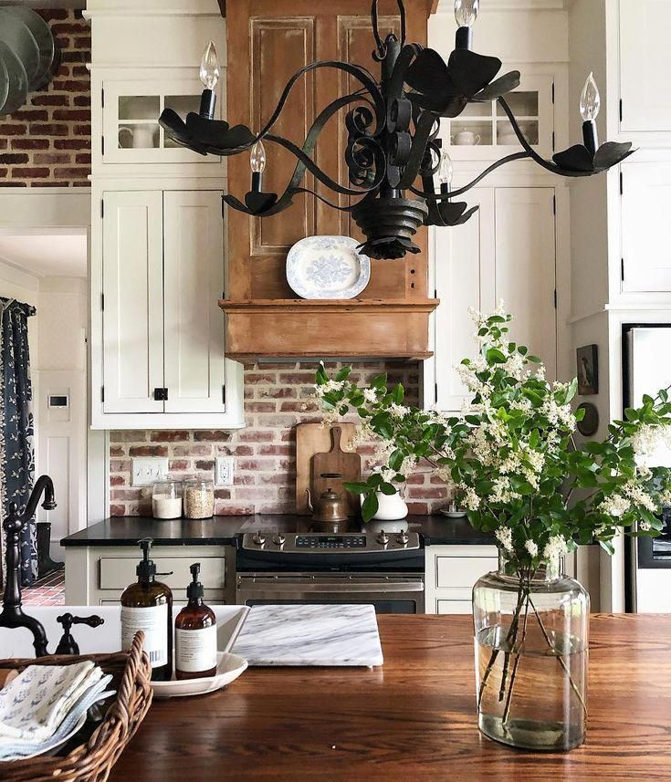 farmhouse kitchen with wrought iron chandelier