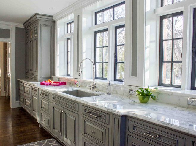 kitchen window above sink kitchen windows above sink a wall of windows allows natural light to flood the gray kitchen kitchenwindow kitchenwin. Interior Design Ideas. Home Design Ideas