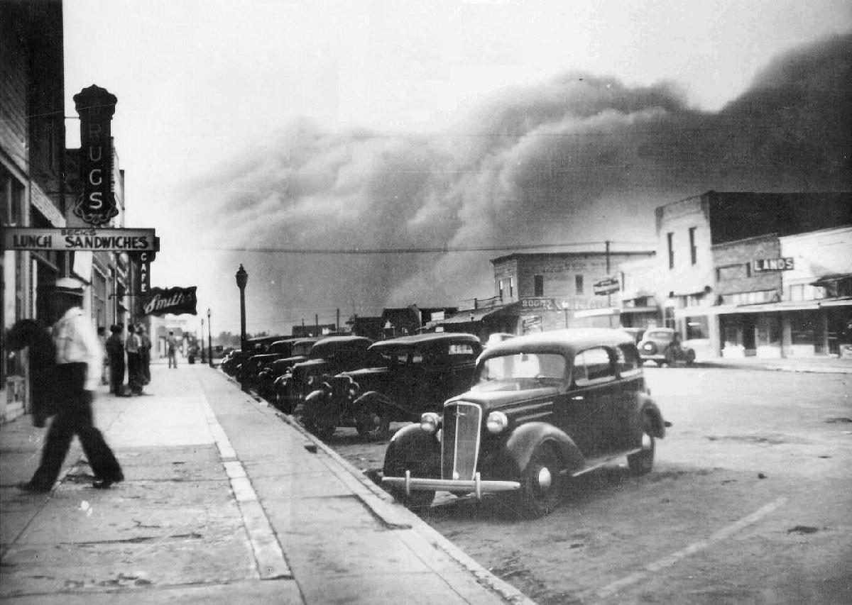 A dust storm about to envelope Elkhart, Kansas, 1937.