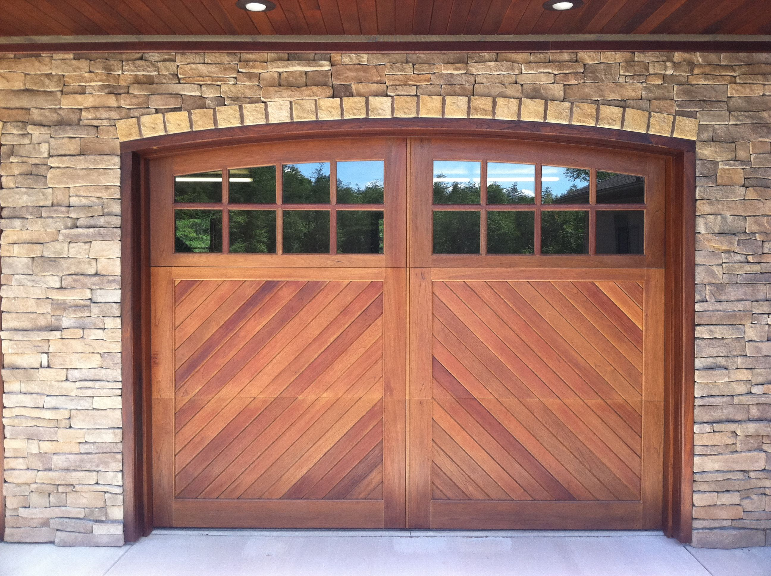 knotty door wood cedar garage portfolio trim design doors with avada arched