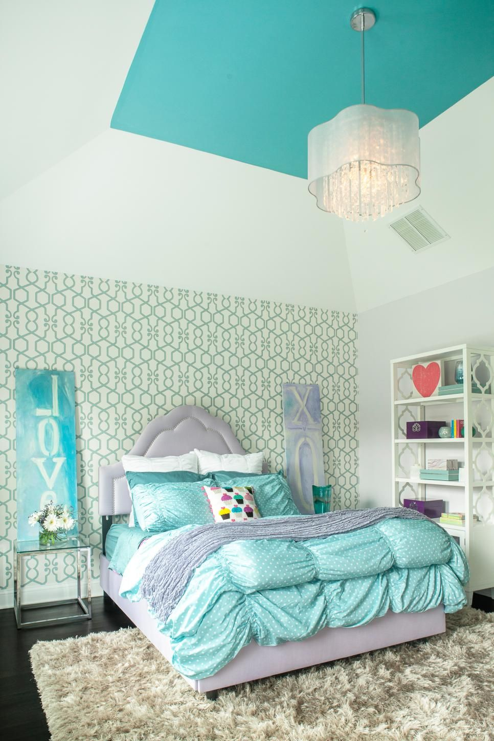 a graphic accent wall serves as the backdrop for a lavender upholstered bed in this girl u0026 39 s
