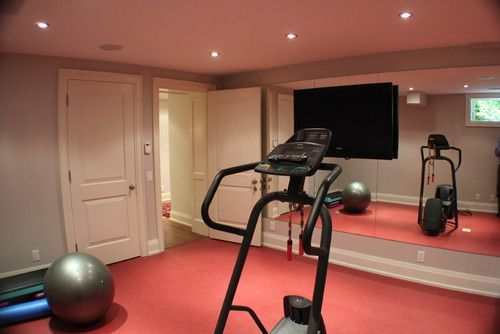 Home gym tv mounted on mirror wall. for the home home gym