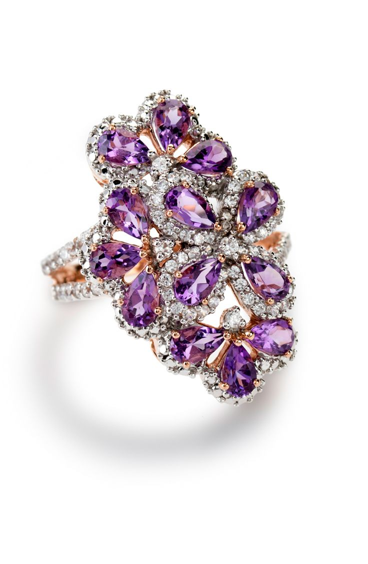 Who could possibly say no to this amethyst? Funky design, outstanding color. | 2.20ctw Pear Shape Brazilian Amethyst With .76ctw Round White Zircon 10k Rose Gold Ring