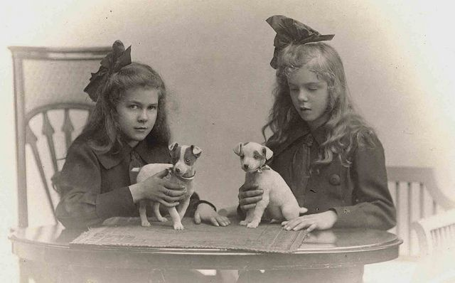 Young girls with their puppies by Libby Hall Dog Photo, via Flickr