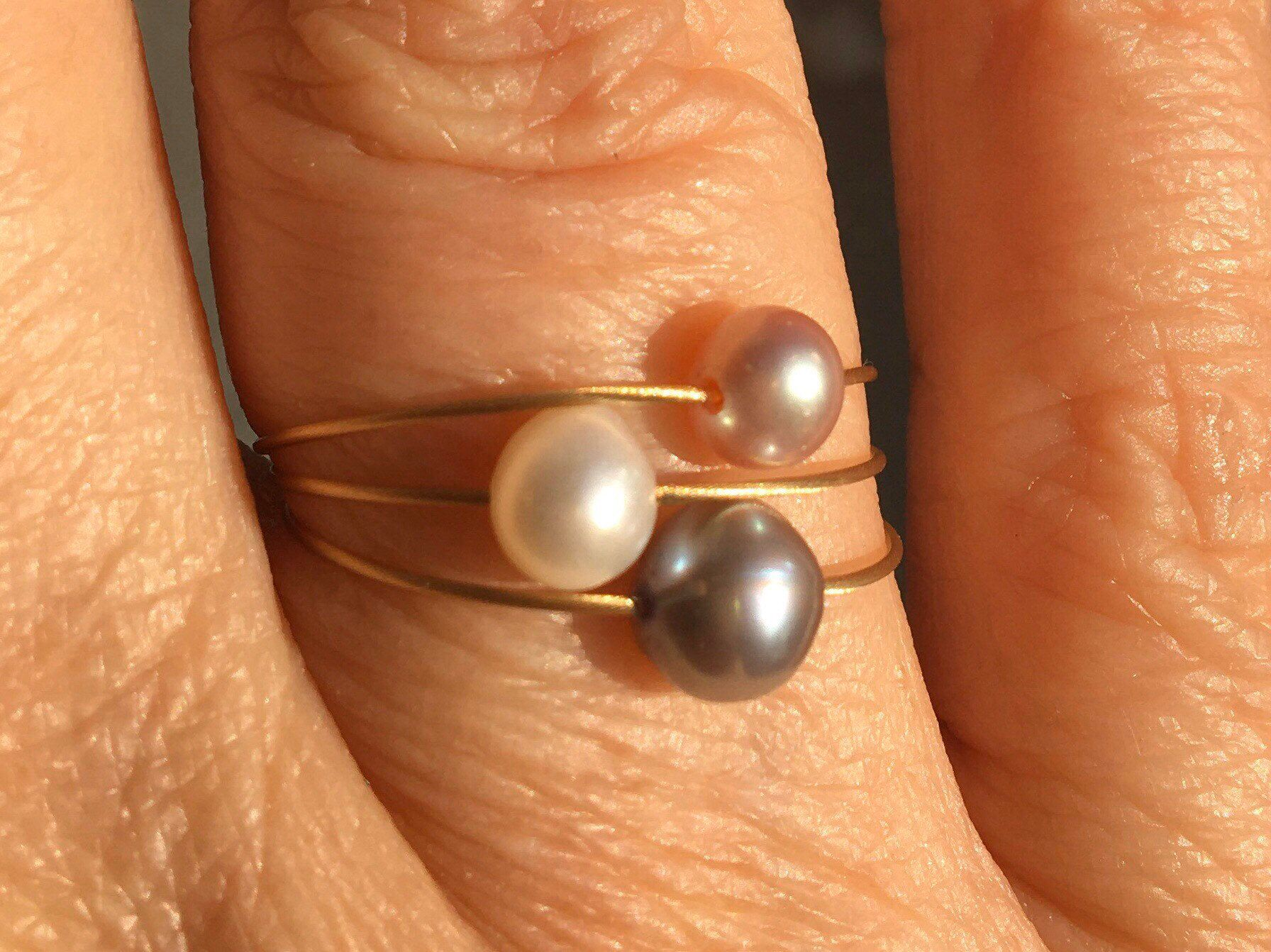 Photo of Freshwater pearl ring. Grey pearl on a wire of gold. Dainty ring.Stackable