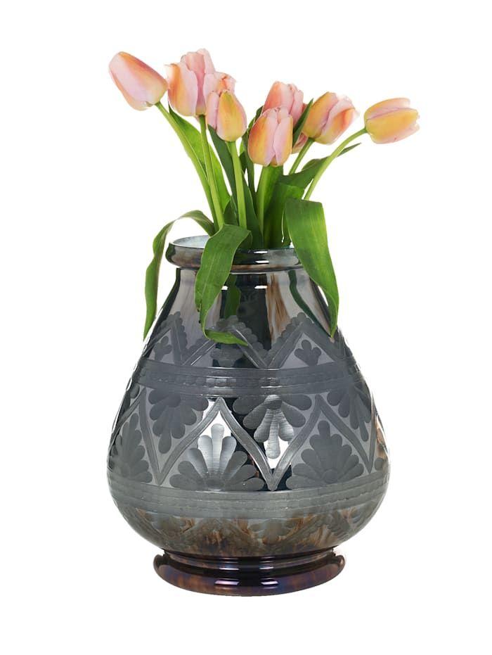 Mit dieser Blumenvase bleiben kaum Wünsche offen, wenn es um ein hübsch dekoriertes Zuhause geht! Sie besteht aus Glas. Ordern Sie die Blumenvase einfach hier in unserem Shop und sie wird schon bald zu Ihnen nach Hause geliefert!