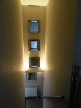 Mirrors Light Up This Dark Stairwell
