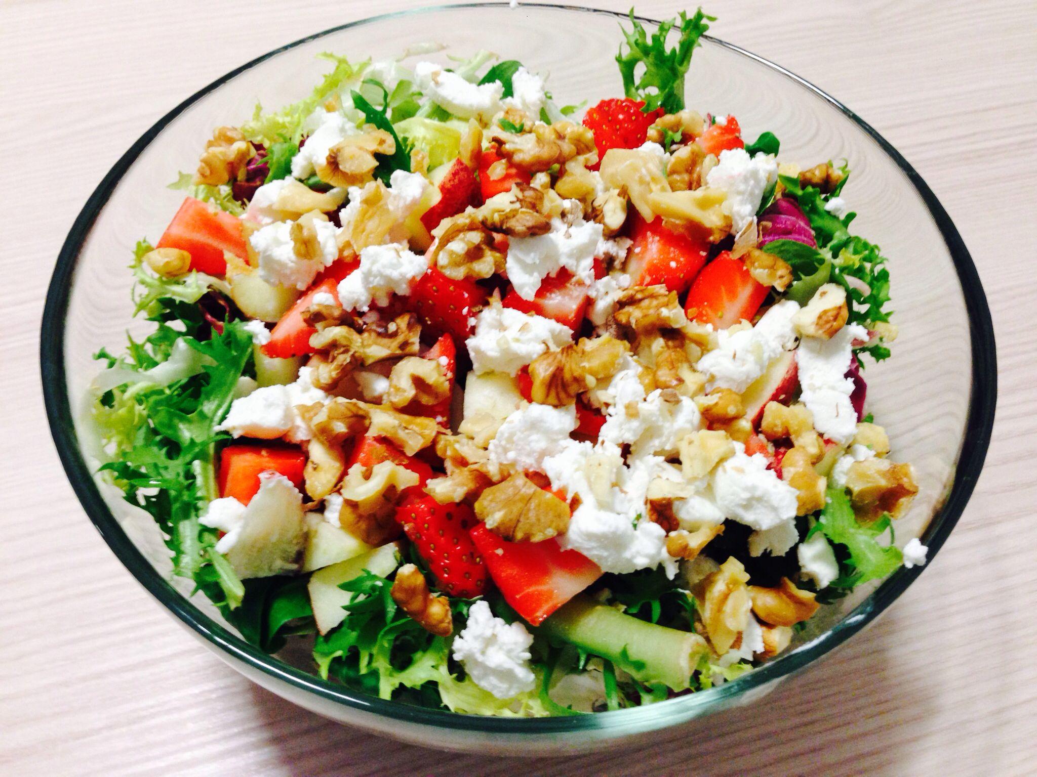 Goat cheese salad !  Goat cheese, strawberries, apple, walnuts and green salad Olive oil,vinegar, lemon, honey, salt and pepper