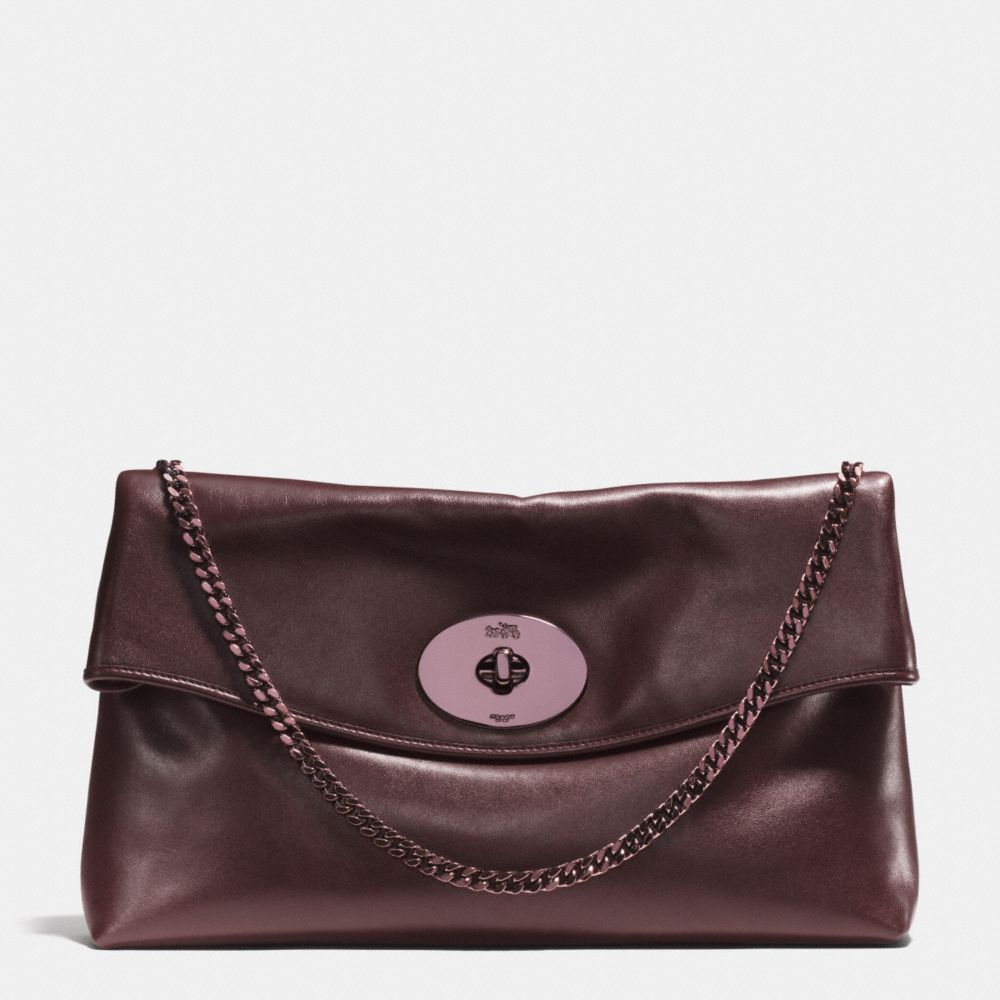 The Large Turnlock Clutch In Leather from Coach i wanna bring this clutch and enjoy going out !
