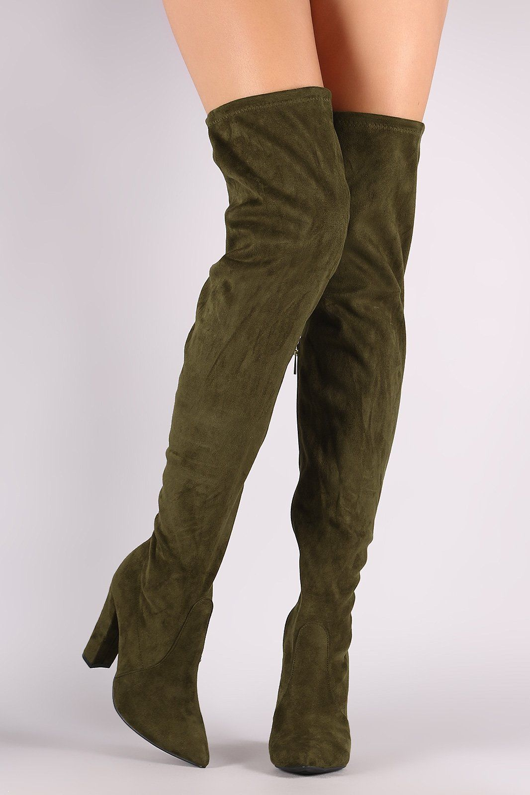b1e6657a8183 These striking boots feature a slightly stretched vegan suede