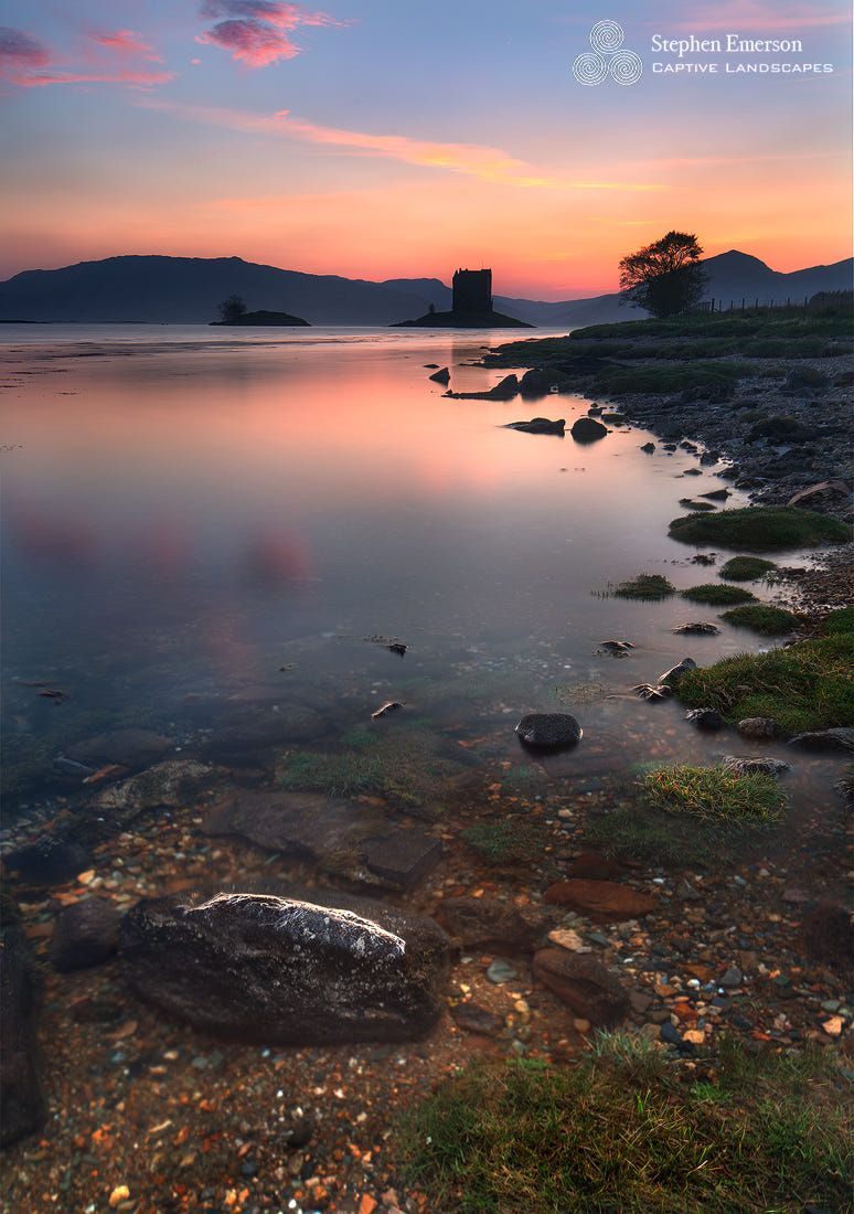 A beautiful calm evening at Castle Stalker, a picturesque castle built on a tidal islet in Loch Laich in Argyll, the Scottish Highlands.