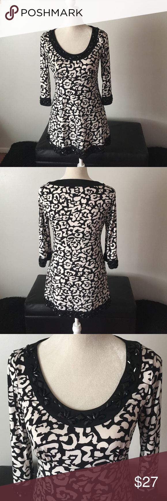 INC international Black/White Fit&Flare Tunic Beautiful Fit and Flare Tunic. Black and an white Off white color, not a bright white. Says petite but will fit regular, just won't be as long. In great condition. Bust/chest measures approx 17.5, length is approx 29 inches. INC International Concepts Tops