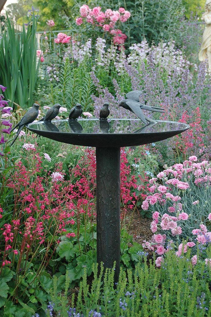Garden feature...birds gathering around their bath. Almost looks like real birds!