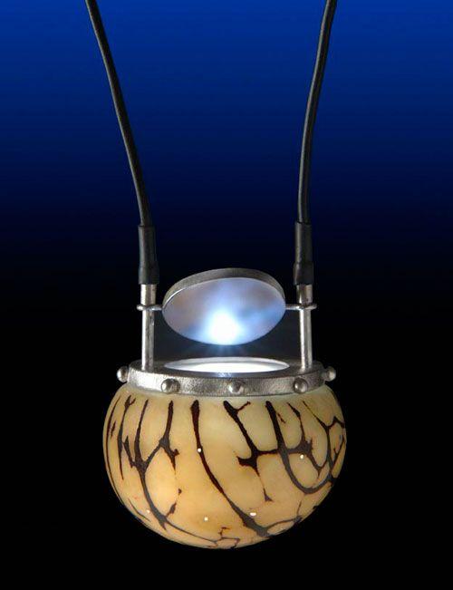 Nicolas Estrada, Artist,   Necklace: Tapunami's Secret 2003  Vegetable ivory, silver, electric components