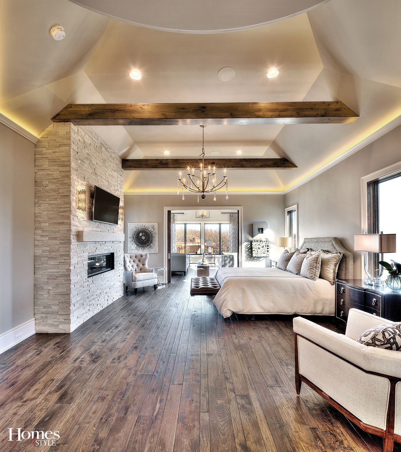 Earthy Elements Prevail In The Spacious Master Suite Thanks To A Stone Fireplace Hand Scraped Hickory Flooring And Remodel Bedroom Master Bedrooms Decor Home