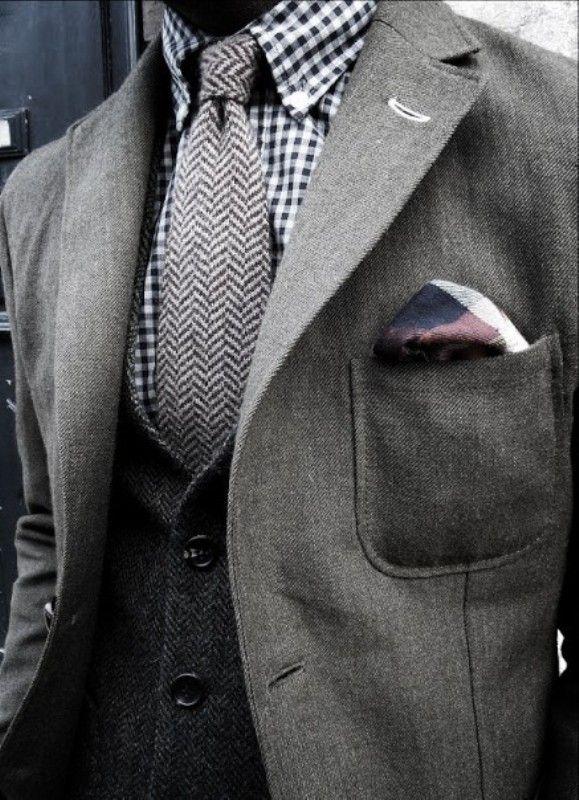 gray jacket, dark gray vest, fishbone tie, checkered handkerchief, black and white gingham button down