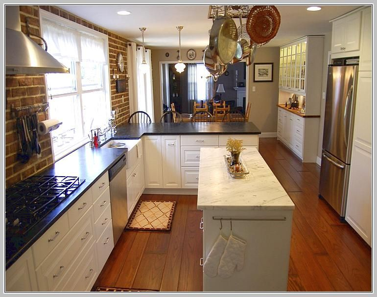 I Like The Island Here And Dark Counters Otherwise Nothing Notable Don T Brick Wa Narrow Kitchen Remodel Small Design