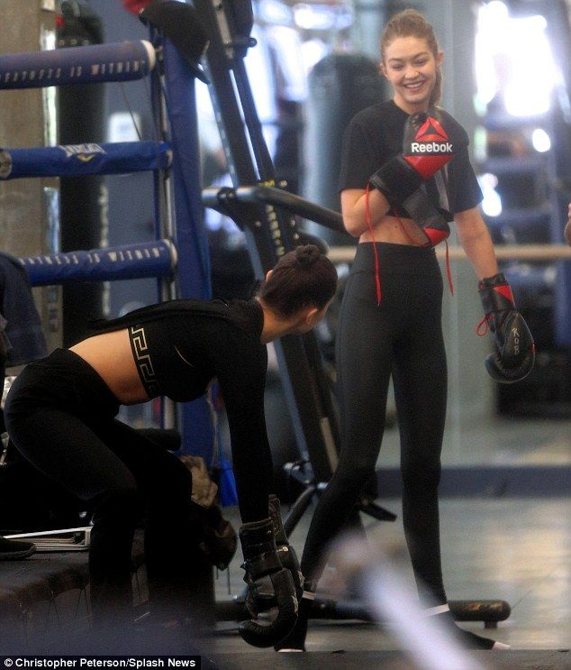 1be23b613f Bella Hadid flaunts her model figure as she joins sister Gigi for boxing  workout after ex The Weeknd hooks up with Selena Gomez