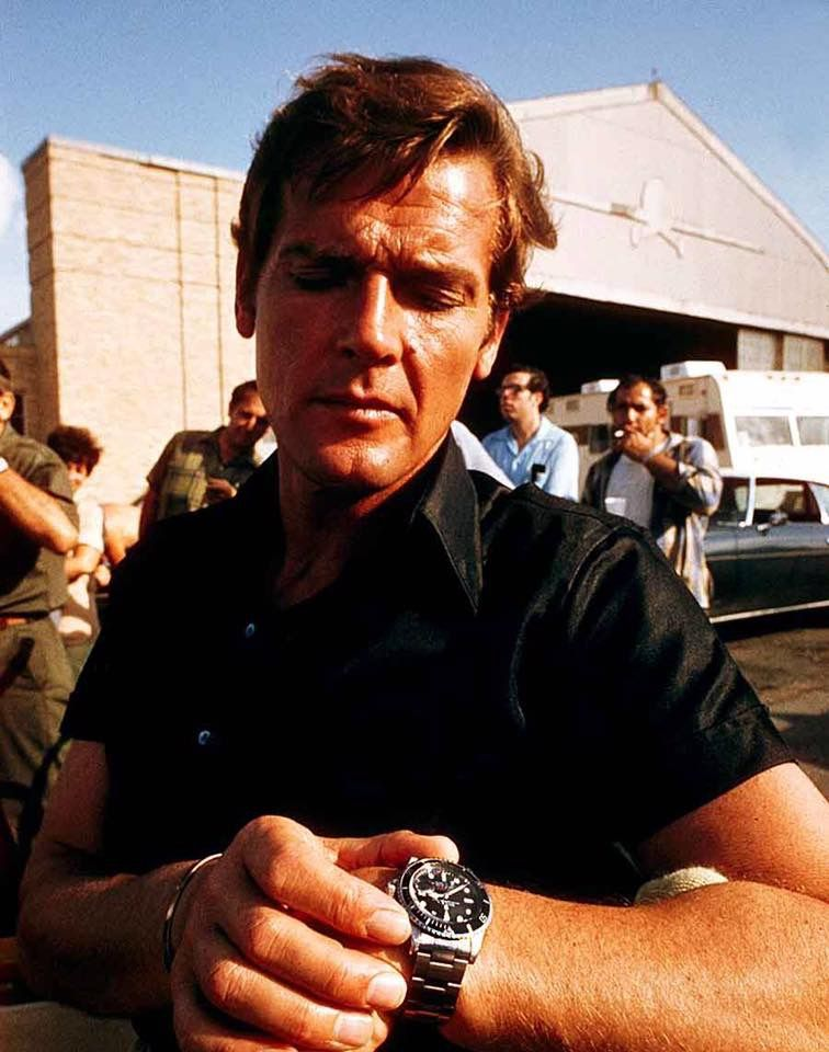 Roger Moore Wearing A Rolex 1680 Red Submariner On The Set Of The