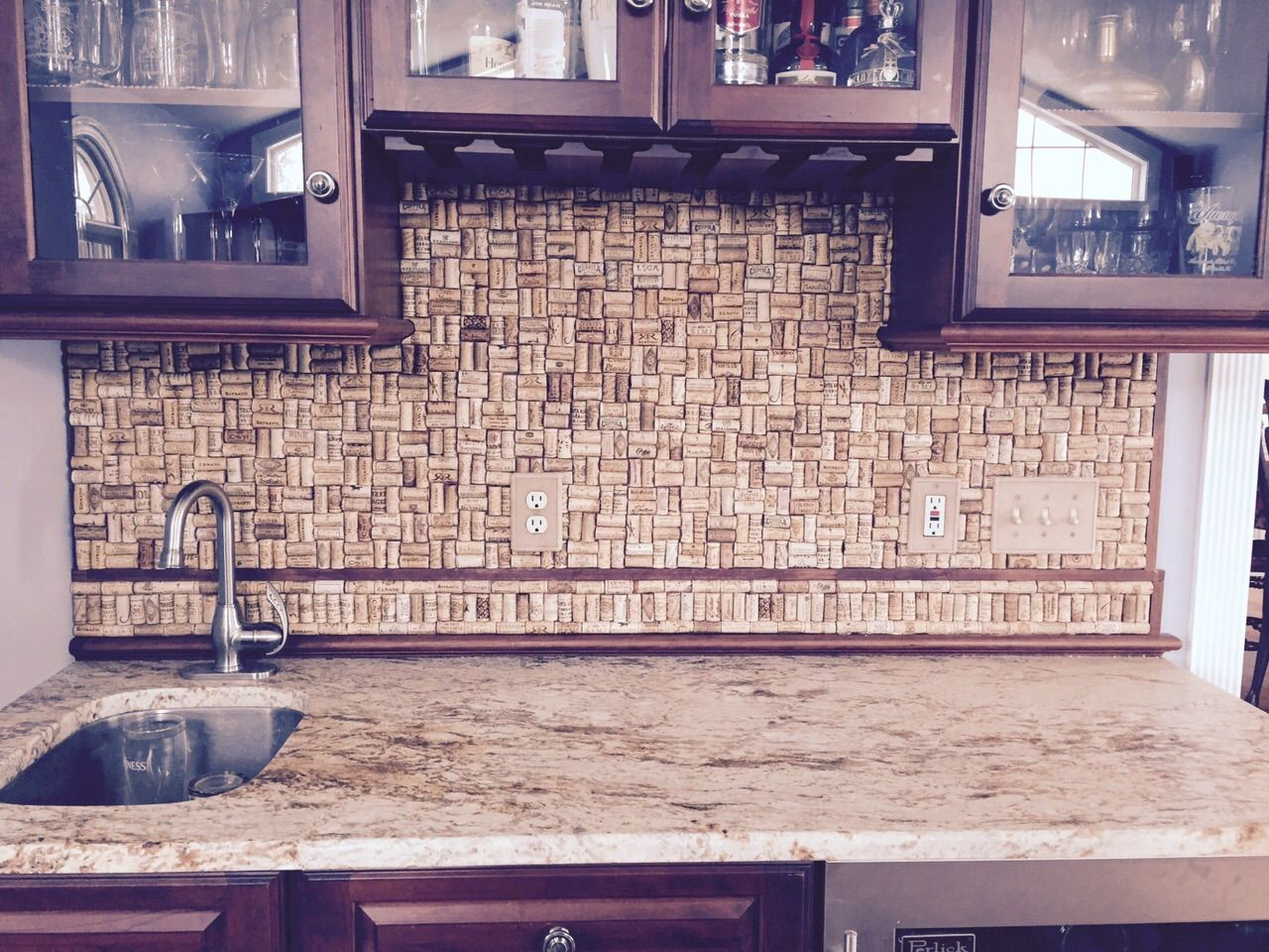 Mom and Dads project Wine cork backsplash on the bar looks great