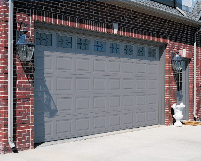Red brick house with a garage door and front door color for Garage door colors
