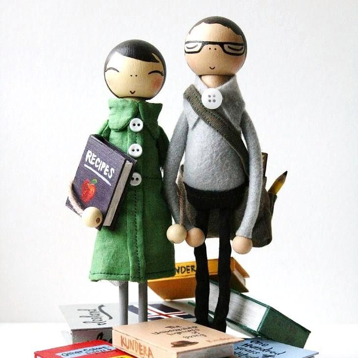 Make the actual bride and groom as a cake topper; not some stylized skinny ideals. And doing normal stuff!