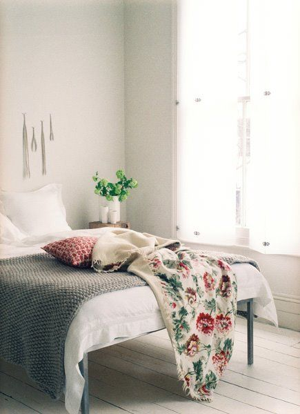 Whitewashed Floors White and Grey Bedding Pop of Red Platform Bed Lovely and Light Bedroom