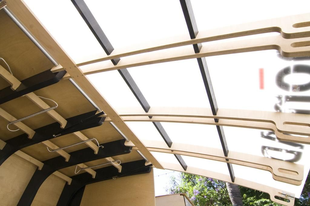 Panels Diffusing Sunlight | During the day, the acrylic panels let diffused light through, adding some shade.