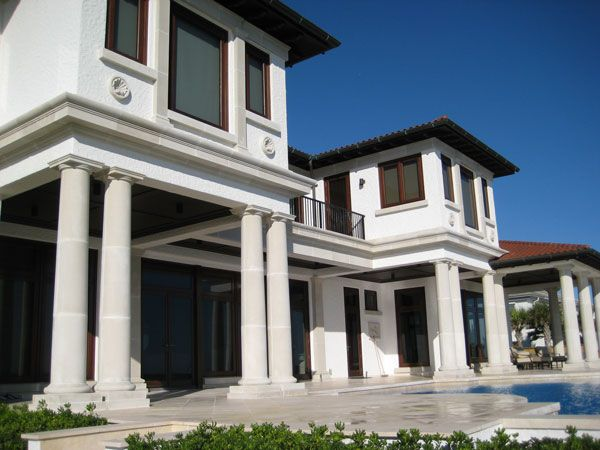 back porch with tuscan style cast stone columns and pool coping