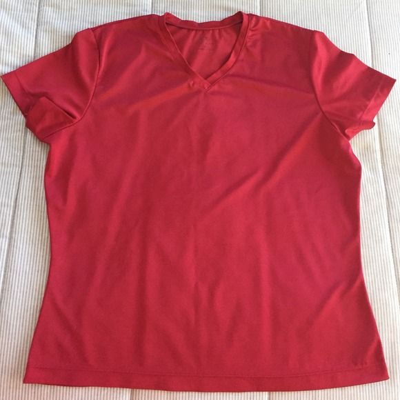 "Red athletic top Polyester/spandex short sleeve athletic top. V neck. 24"" from shoulder to hem. Excellent condition. Champion Tops"