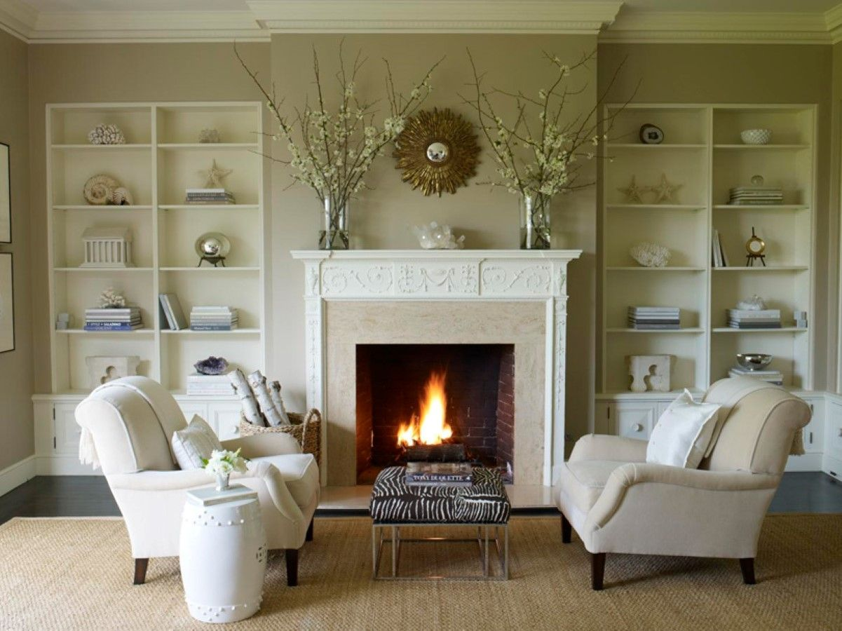 soft brown living room shows neutral seating area set in front of fireplace between wall shelves design