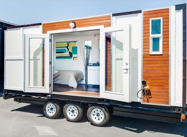 Man Converts Shipping Container into Tiny Home on Wheels Sea