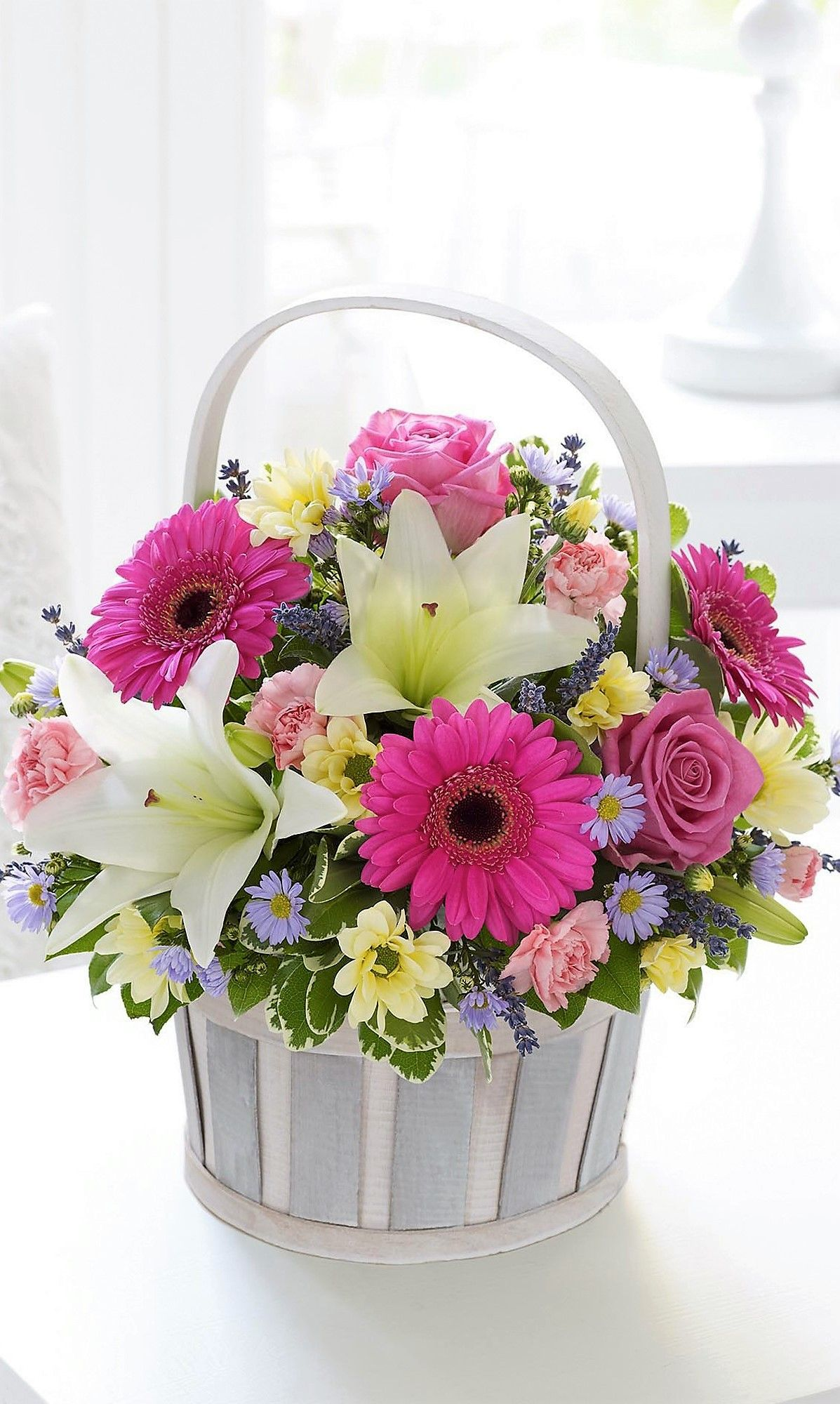 Basket flower arrangements image by We're Two Pinners. on