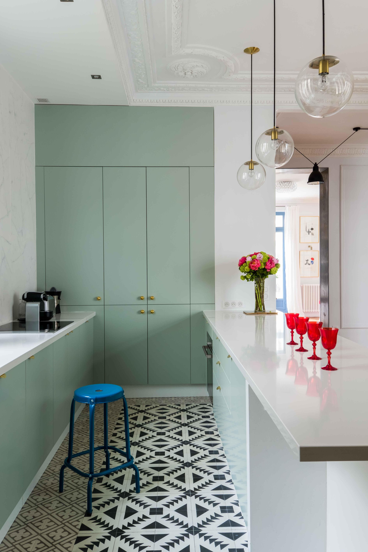 Parisian apartment kitchen. Black and white tiled floor ...
