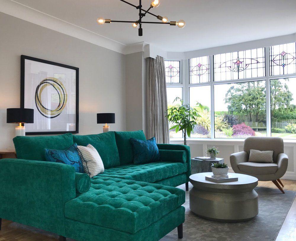 living room  emerald green velvet sofa  hammered metal