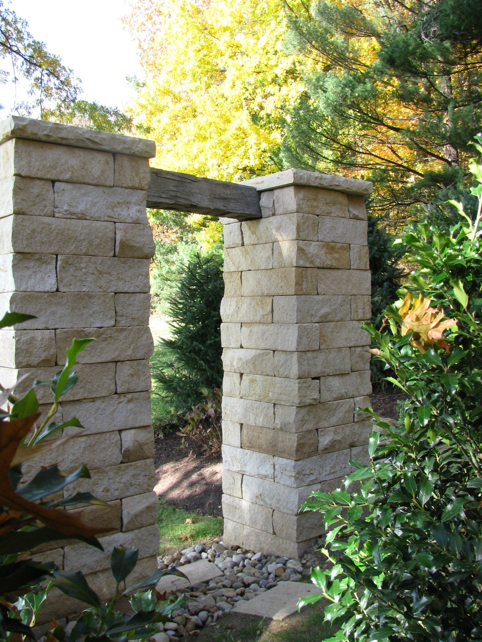 wrought iron fence and gates with sandstone pillars