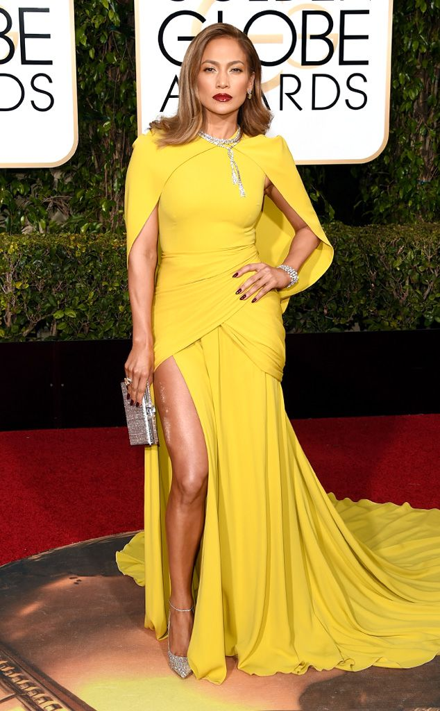 96aa418f15a Jennifer Lopez - yellow dress and contrasting burgundy stiletto nails by  Tom Bachik.