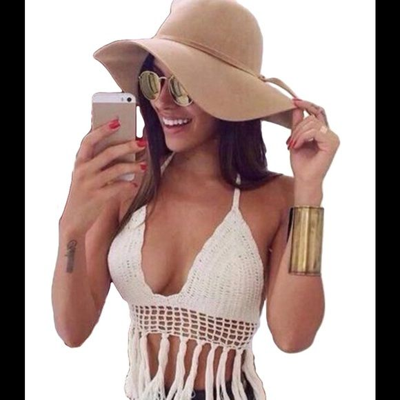 WHITE CROCHET BOHO CROP TOP TASSLE BRALETTE SHIRT ♦️Just IN ♦️ ✌️WHITE CROCHET BOHEMIAN STYLE CROP TOP TASSLE BRALETTE SHIRT *NWT*   ONE SIZE FITS MOST ( Boutique Brand)   TOP TREND   ALSO AVAILABLE IN BLACK > ASK ABOUT BUNDLE DISCOUNTS :) ThinkVintageOnline Tops Crop Tops
