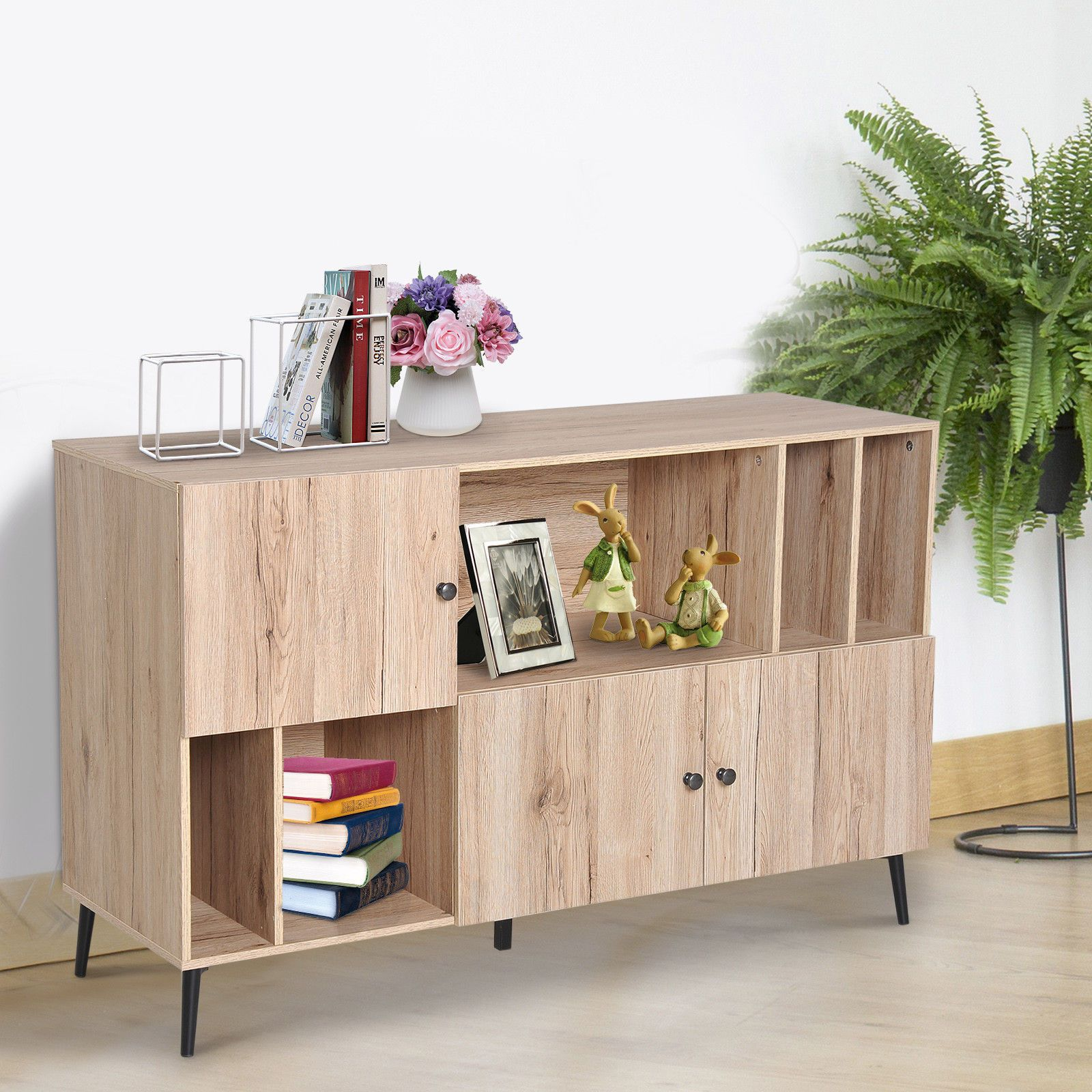 Scandinavian Sideboard Cabinet Buffet Storage Metal Legs Oak is part of Living Room Storage Buffet - Stylish Design Scandinavian style oak wood buffet to add a touch of elegance to your interior  Perfect for living room office bedroom entrance etc   	Large storage space 3 closets with doors and 5 recesses of 3 different sizes allowing you to store your books CD Blu ray or decorations and each closet is equipped with a round opening handle   	Metal legs 4 inclined metal legs for maximum stability and elegance   	Sturdy Structure Manufactured of robust particle board for long term use   	Overall dimensions 120L x 39W x 74H cm; Foot diameter 3 cm (height 12 cm); Max  recommended 50 Kg
